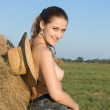 Beautiful girl on a fresh hay - Stock Photo