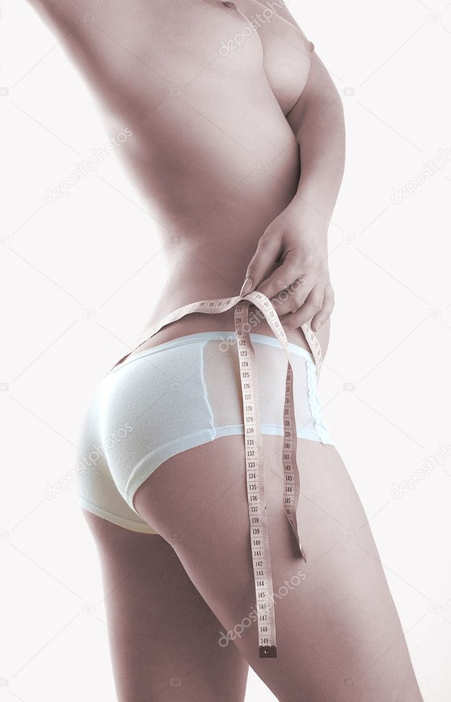 The girl measuring a waist — Stock Photo #1188932