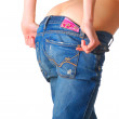 Girl putting down jeans — Stock Photo