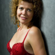 Stock Photo: Woman in red brassiere closeup
