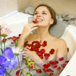 Stock Photo: Woman in rose-petals